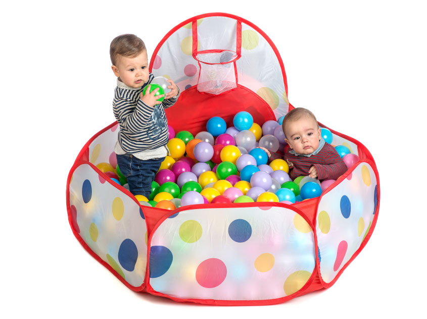 kids playing inside soft play balls pool
